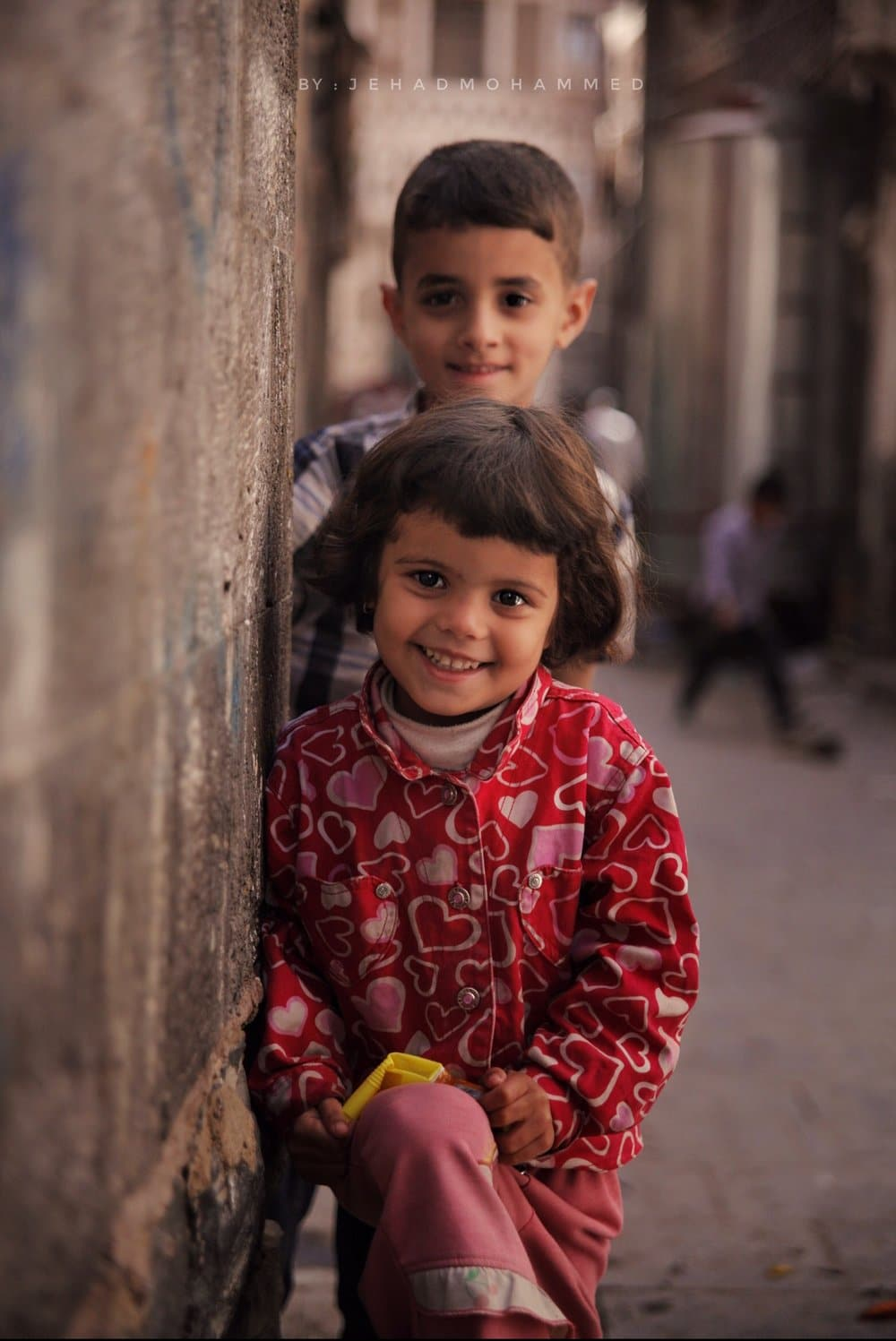 Faces of Two children in the Streets of Old Sanaa City - Jehad